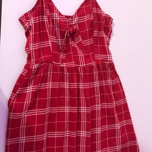 This is a red plaid dress with a bow in the front